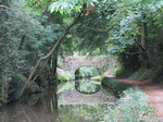 SX09626 Reflected bridge on Monmouthshire and Brecon Canal.jpg